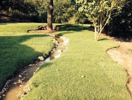 Babbling Brook Running Through Garden From An Upper Pond