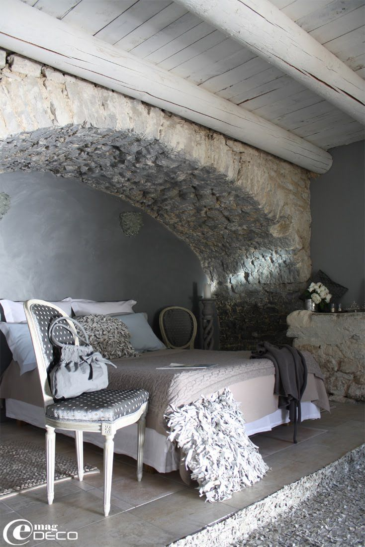 This is a bedroom suite in a hotel in France! Love that wall and see how they are trying to make their old beams new--quite the twist.