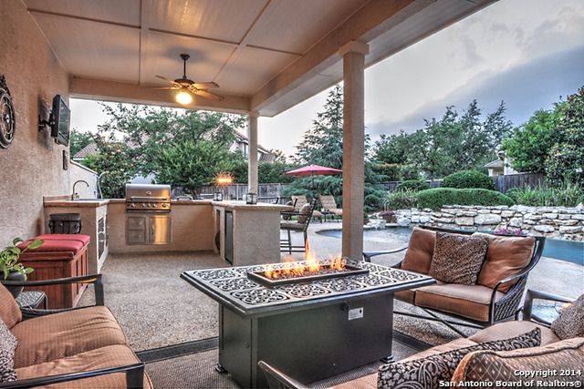 How cool is this outdoor fireplace? The perfect location to enjoy backyard fun all summer long. You can cook in the outdoor kitchen, warm up next to the fire, take a swim in the in-ground, then repeat. San Antonio, TX Coldwell Banker D'Ann Harper, Realtors $675,000