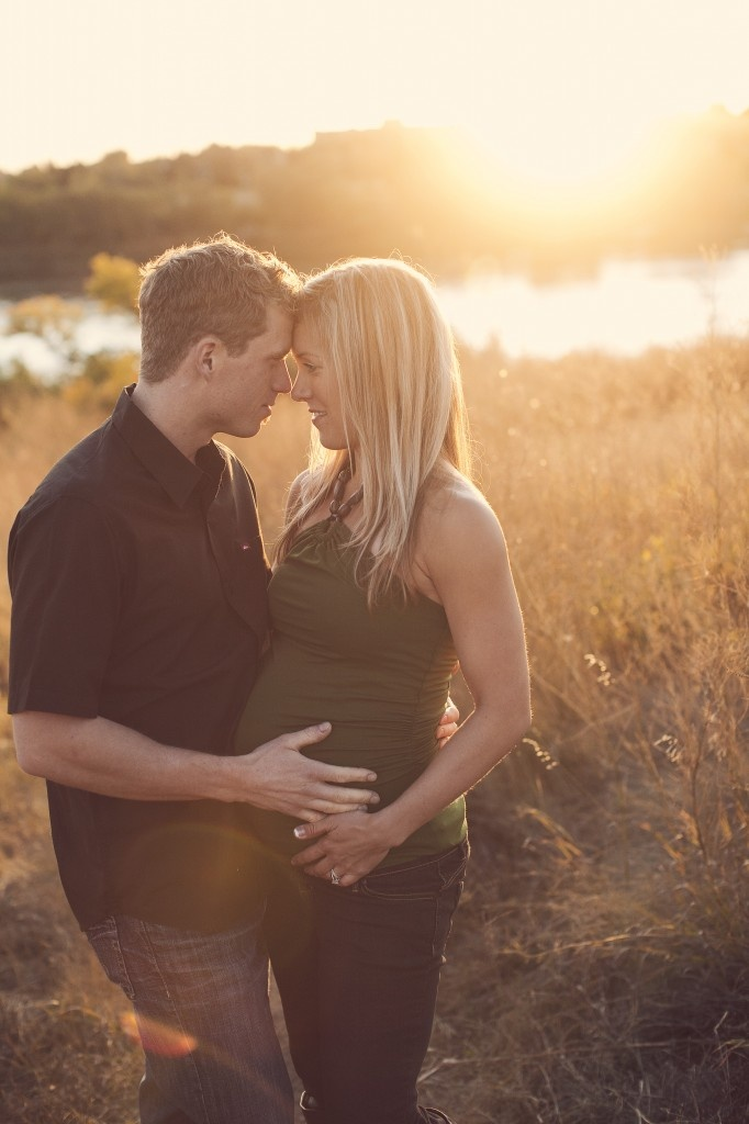 adorable maternity photo- Love the golden light behind the two!