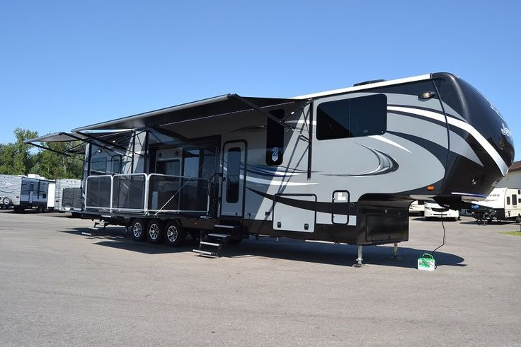 ULTIMATE TOY HAULER 5TH WHEEL!!! 2016 Jayco Seismic 4212 A 12' cargo area for all your toys! Double awnings for maximum shade while you relax outside on your patio and ramp party deck! A luxurious private master suite just for you with a walk-in closet, access to the bathroom and a huge bed! Power bunks in the cargo area and an overhead loft! Along with a second bathroom, the kitchen is divine and the sofa will have you lounging! Call our Seismic expert Jacob Goodyear 989-860-2620