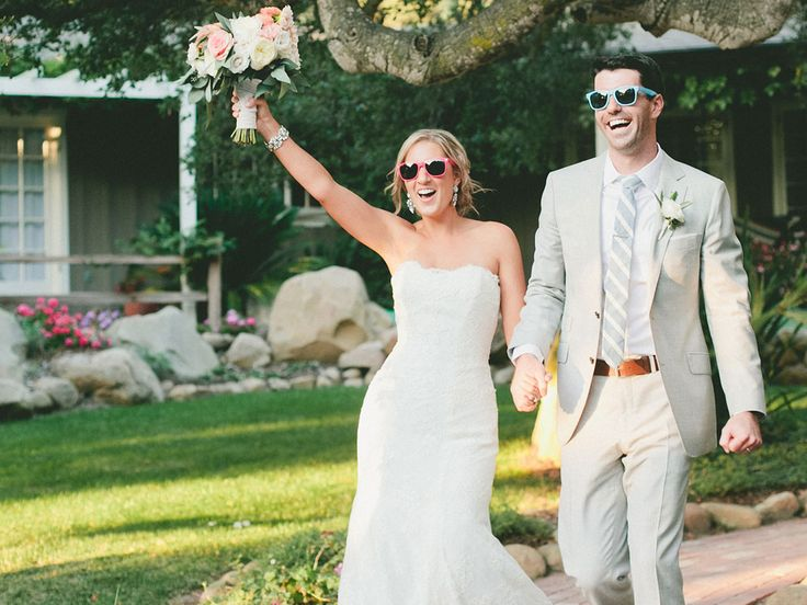 15 Awesome Entrance Songs You Might Have Overlooked | Photo by: Onelove photography | TheKnot.com
