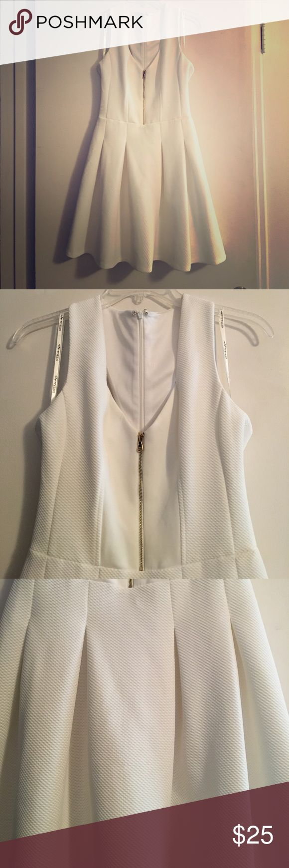 Guess White Fit n Flare Dress Guess white fit n flare dress with gold zipper. Beautiful fabric detail with interesting strap detail in the back. Gold zipper is decorative but functional. Has hidden zipper in the back. 100% lined. Can be worn with a bra (dress straps cover bra straps). Excellent condition. Beautiful white. Never worn Guess Dresses