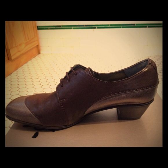 Fidji oxfords, brand new! 1.5 inch heel on a classy Oxford. Deep brown with rusted silver top and sides. Comfortable and stylish. I love this shoe. Selling it because I bought it a size too small and they can't be returned! They go well with pants and skirts. Fidji Shoes Flats & Loafers