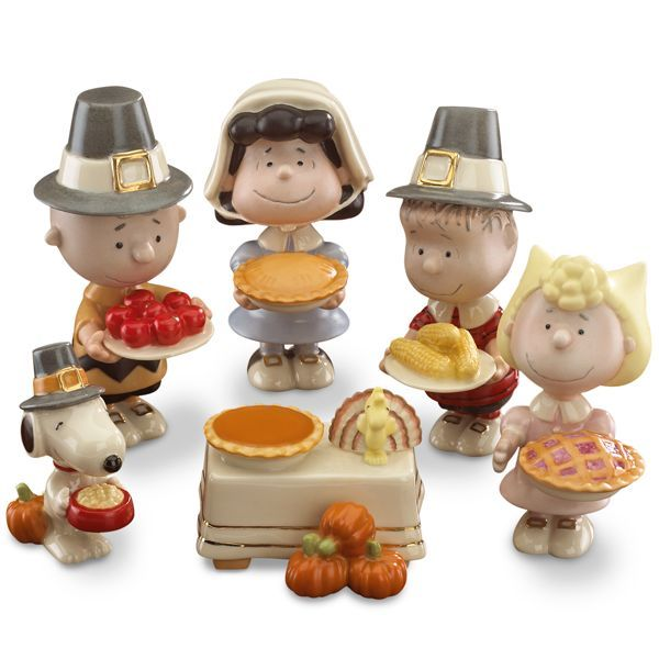 """PEANUTS® 5-piece Thanksgiving Figurine Set by Lenox.  We've all seen the Peanuts gang connected with Christmas and Halloween, but here they are celebrating Thanksgiving!  Charlie Brown, Lucy, Linus, Sally and Snoopy are dressed like Pilgrims and ready to eat!  The figures are approximately 4 inches tall and are made of """"hand-painted ivory china accented with gold""""."""