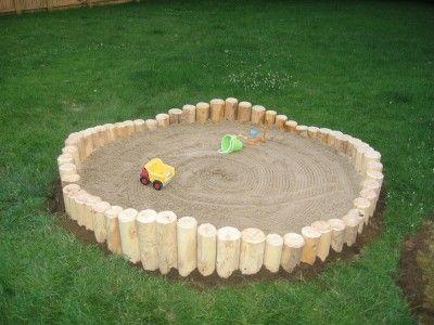 sandbox!  Good way to use firewood.  Super cheap sandbox