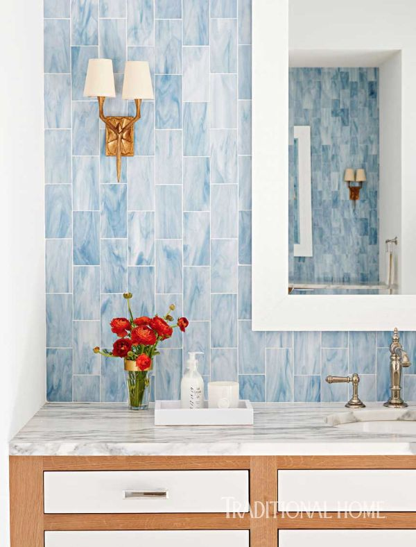 Blue tile from New Ravenna was installed vertically for visual interest in the s…