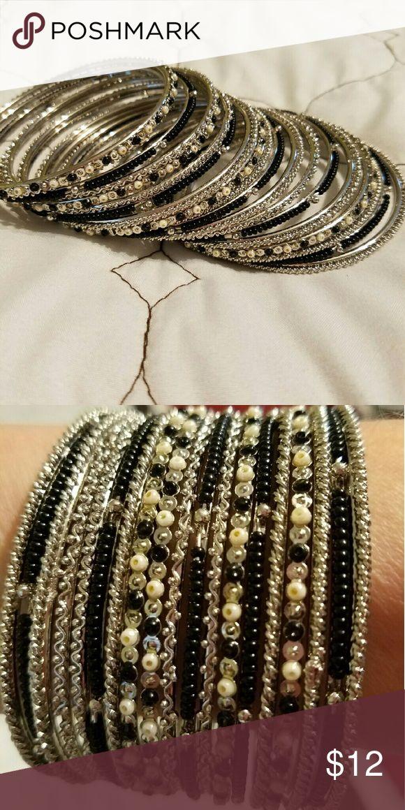 Bangle bracelet Siler and black Bangle bracelets never worn Jewelry Bracelets