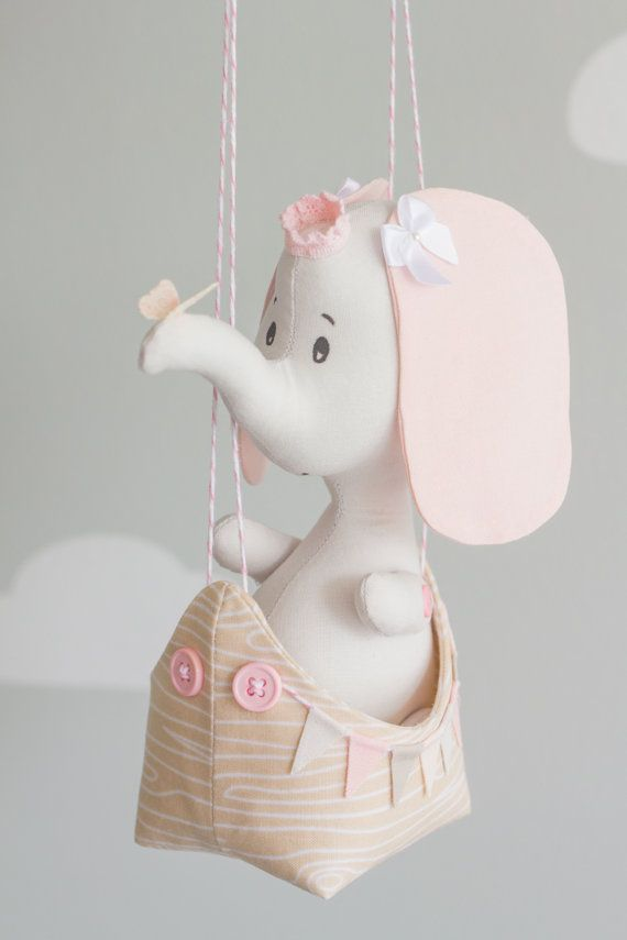 My newest and MOST adorable baby mobile design. Perfect for a travel theme nursery. The baby elephant is sitting in a tiny boat being carried