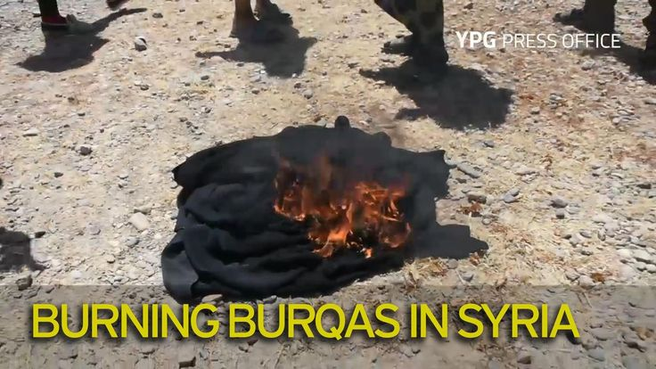 Women burn burqas and men shave their beards as they celebrate escape from ISIS stronghold in Syria - Mirror Online