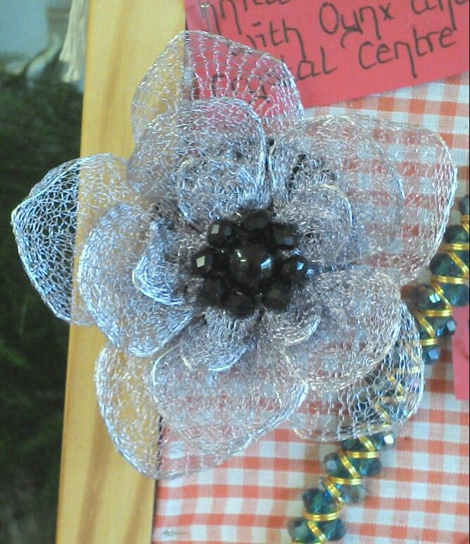 Wire mesh flower brooch with black oynx and chezck crystal