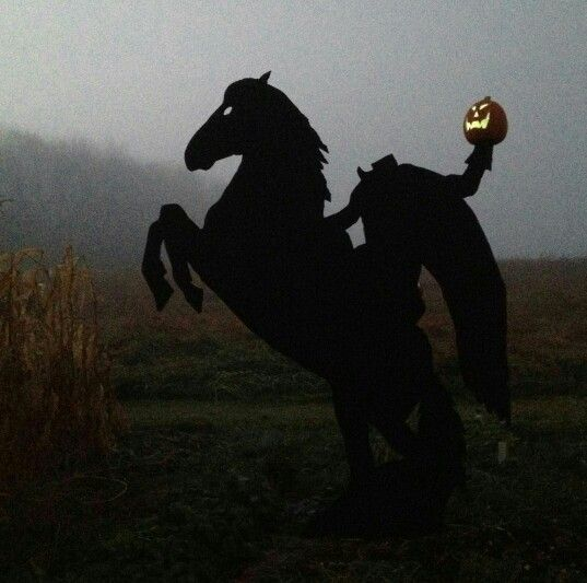 """Headless horseman silhouette. 1 and a half 4x8 sheets 1/2"""" pressure  treated plywood with pumpkin on arm stand. Impressive at sunset. Needs to be in front of something that is well lite at night to get the best effect. Was a crowd pleaser."""