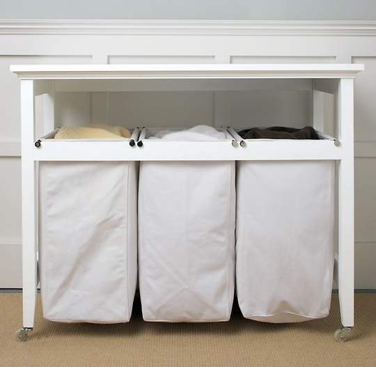 10 ways to organize your dirty laundry laundry folding tables small desks and laundry sorter. Black Bedroom Furniture Sets. Home Design Ideas