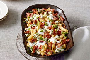 Smothered French Fries. Fries are smothered in a creamy garlic-ranch sauce and then topped with blue cheese, bacon and green onions. Beyond yum.