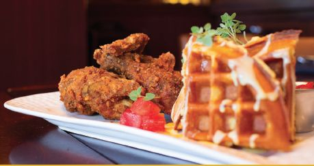 Chicken and Waffles - Cajun fried breast, leg and thigh, cornbread waffle, lemon creme anglaise, salted maple butter syrup, and marinated watermelon. Royal Pig Pub & Kitchen 350 E. Las Olas Blvd. // Fort Lauderdale 954 617 7447 // royalpigpub.com