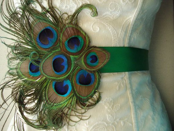 Choose your own color satin sash decorated with this ornament of beautiful peacock feathers and sword curls. All hand made and assembled. Perfect to