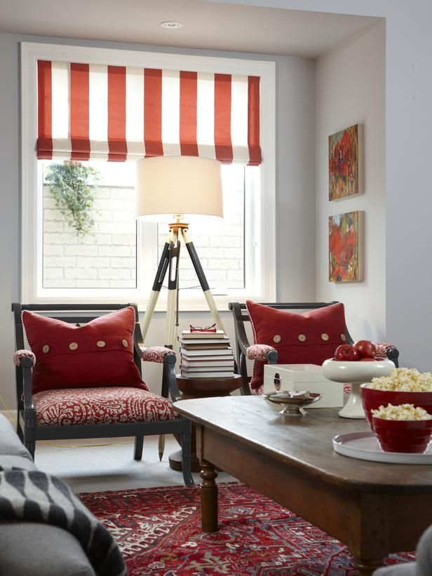 basement by Sarah Richardson---I'm loving the reds (they remind me of vintage movie theaters and popcorn buckets), and the tripod-style area lamp is a playful yet functional addition, and right up my style alley :)  I would love to hang out here if it was my home!