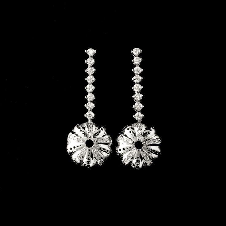 18ct white gold and diamond Baby Kina earrings.