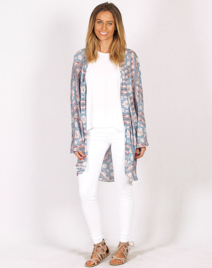 This cape is so beautiful! Featuring a stunning print its an easy wear layering piece in a lovely light fabric, perfect for the in-between days   Features:  - Steel Blue , Pink and White Diamond Floral Print  - Kimono Style - Front Panel Stitch Detail   - Open ...