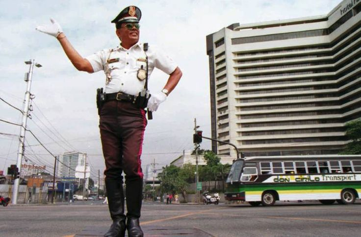 Manila Traffic Cop - does anyone else think he looks like he's about to break out in song?
