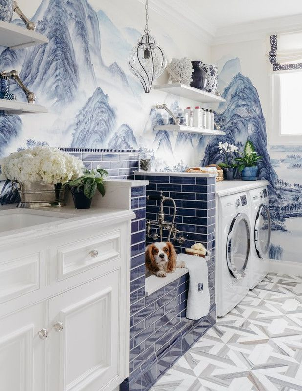 subway tile and wallpaper in a laundry room