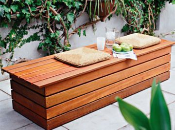 This garden or courtyard bench seat is really a mini shed.