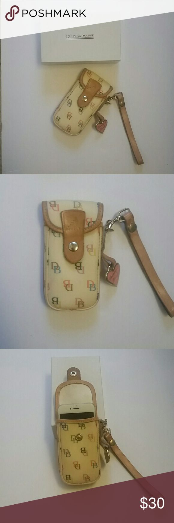 """Dooney & Bourke cellphone wristlet Dooney and Bourke cell phone wristlet.  Currently has iPhone 6s in photo but also fits phones of similar size.  Also, has back pocket for cash or credit cards. Made with genuine leather and monogram coated canvas. Can also be used as cosmetic bag, etc.  Length 5.5"""", width 3"""",  depth 1.25"""".  Excellent condition.  Comes with original box.  Cell phone not included. Dooney & Bourke Bags Clutches & Wristlets"""
