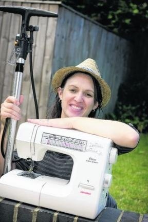 Dr Kate Coldwell, with a bike pump and a sewing machine she has for loan