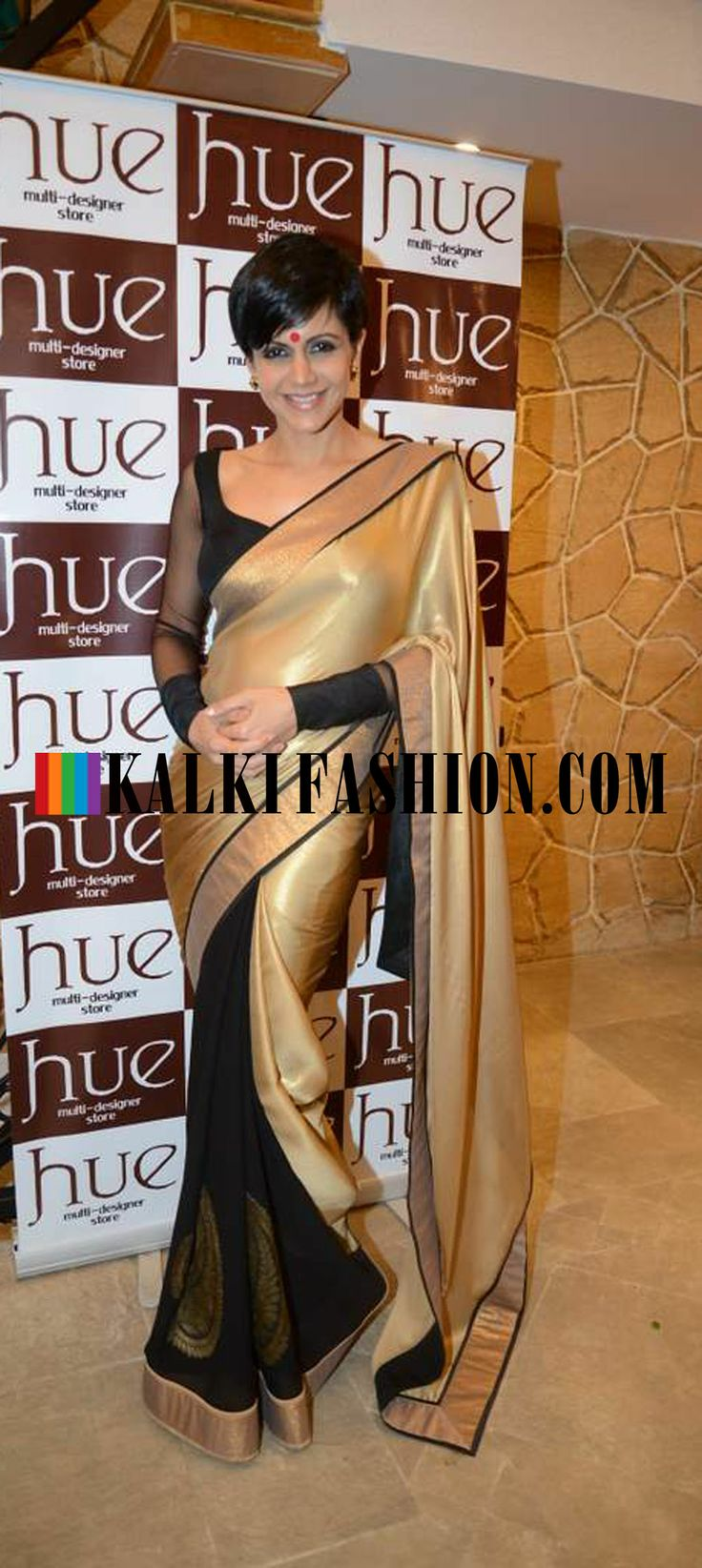 http://www.kalkifashion.com/ Mandira Bedi in Half and half gold, black saree to attend the reopening of designer store Hue by Mahima Bansal