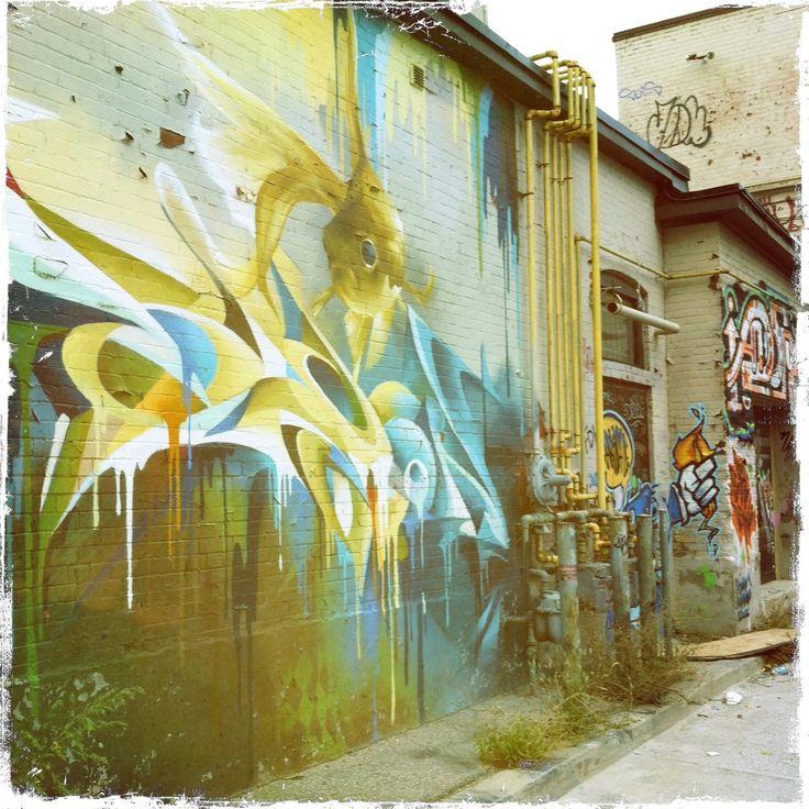 Goldfish on a wall. Street art in Toronto. Graffiti art.
