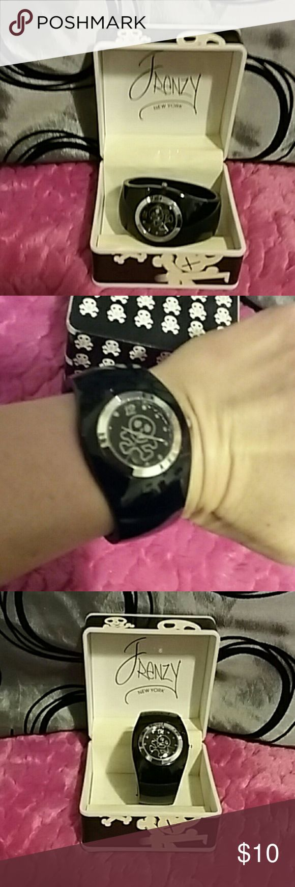 Frenzy Black Skulls and Crossbones Cuff  Watch Frenzy new York black cuff wrap around watch, comes in original case, has skull and cross bones on face of watch and on watch box, cuff is opens up a little bit to wrist on watch, will fit someone with a small to medium wrist, on cuff has a small scratch which can see in last pic, comes with working battery, very stylish and rocker style watch, has always been kept on original box, just see number 6 and 12 and rest of numbers is dots on the…