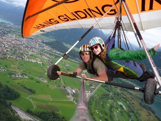 Go hang gliding  (Interlaken, Switzerland). Doesn't really matter the place, but I've always wanted to try hang gliding. .