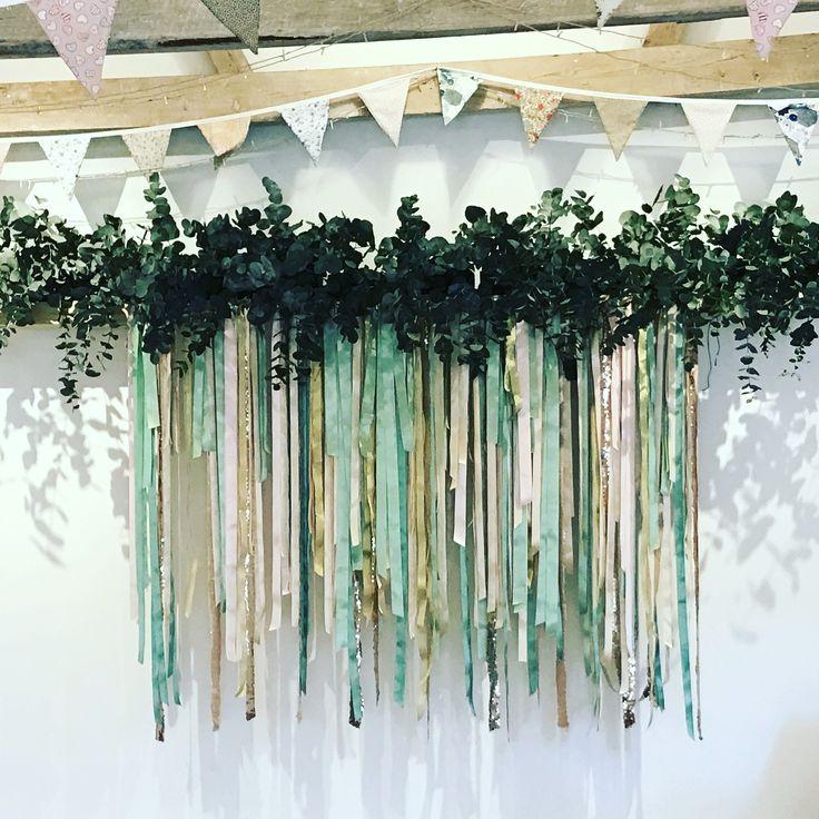 Bespoke ribbon garlands made to order. Foliage and ribbon backdrop