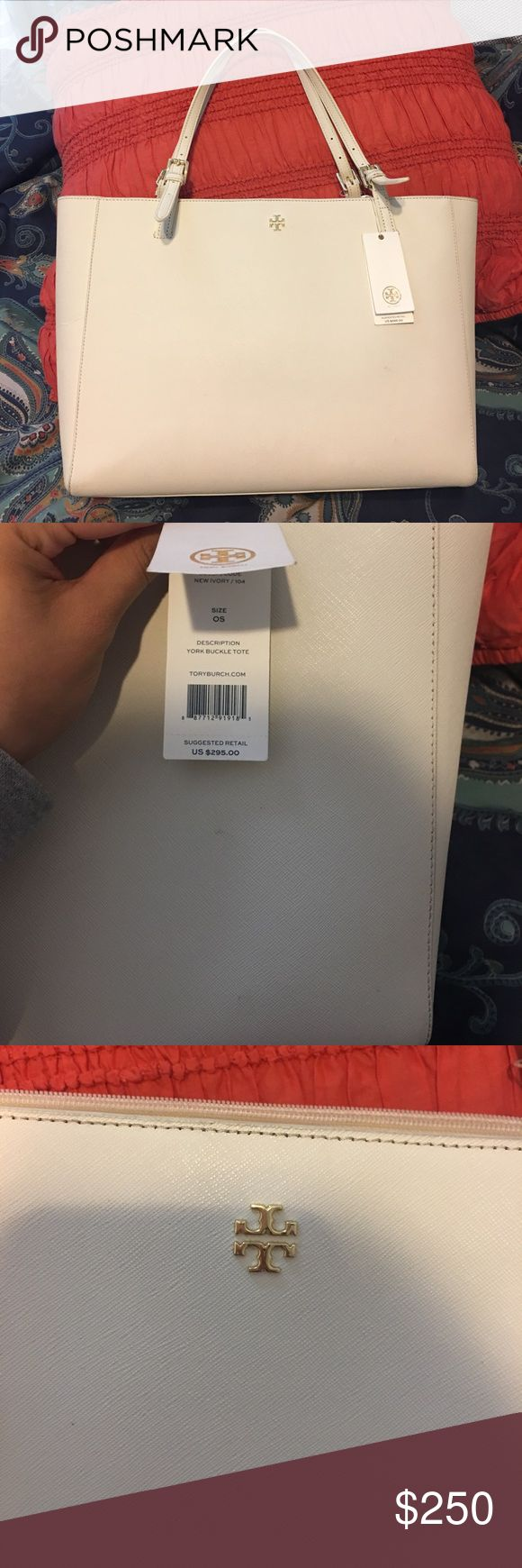 TORY BURCH NWT! Selling a large tote, ivory color. Great condition. Still has the tag, this purse is perfect for laptop and tablet carriers because it has a compartment for that. 4 compartments and zipper inside. Tory Burch Bags Totes