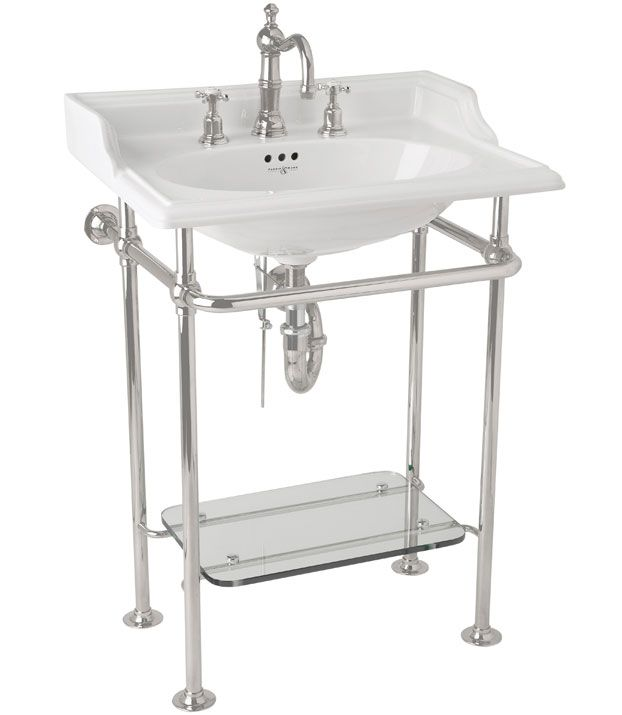 The polished-nickel stand of Perrin & Rowe's Victorian basin includes a built-in shelf, so extra linens are always within arm's reach.