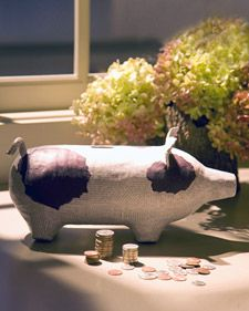 turn a 2 litre bottle and egg carton into a pig bank or forget the money slot and make a sculpture... use an upcycled light weight cardboard box {cereal, crackers, etc.} to make wings for flying pig