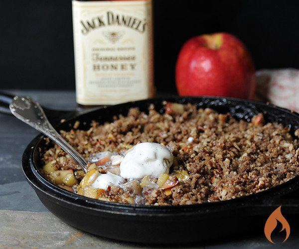 Impress the guys by cooking this Jack Daniel's Tennessee Honey Whiskey Apple Crisp on the grill. 6 servings--Pecan Topping ¾ cup chopped pecans ¼ cup flour ¼ cup brown sugar ¼ cup granulated sugar ½ tsp. vanilla ¼ tsp. cinnamon ¼ tsp. salt 4 tablespoons butter, melted --Filling ½ cup, plus 2 tablespoons granulated sugar 1 tablespoon cornstarch 3 apples, diced 3 tablespoons Jack Daniels Tennessee Honey Whiskey 1