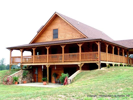 Grandfield by Honest Abe Log Homes with a 270 degree wrap around porch plus walk out basement. Foundation cover is log siding ... Contact Jack@LogHomesByJack.com at 800 767-4916