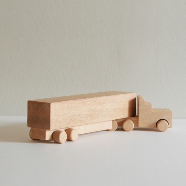 This toy truck, with its lovely silhouette, is made of smooth beech wood with rolling wheels. Clean and modern yet with an heirloom quality.Wooden Truck | gifts | shop | neo-utility
