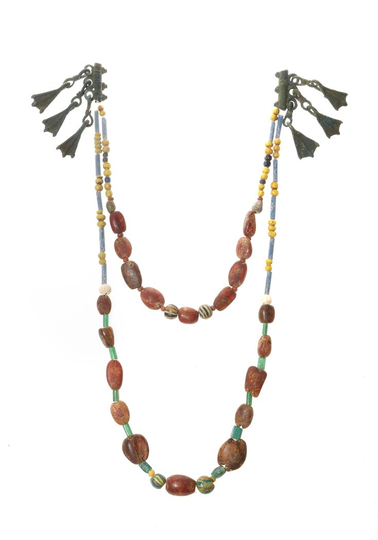 Amber necklace with bronze jewelry. Viking age.