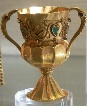 The Treasure of Gourdon – France  discovered in 1845, is a hoard of gold, the objects dating to the end of the fifth or beginning of the sixth century, which was secreted soon after 524. When it was found the hoard comprised a chalice (shown), a rectangular paten, similarly applied with garnets and turquoises in cloisonné compartments, together with about a hundred gold coins dating from the reigns of Byzantine emperors Leo I (457-474) through that of Justin I (518-527).: Turquoise, Emperors Leo, Treasure, Garnet, Coins Dating, Reign