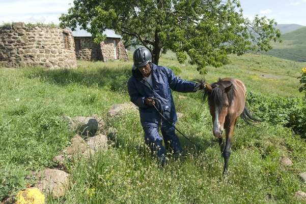 Pony dispatch rider Tsotetsi Lekhitla outside Semenanyane health clinic in the mountainous district of Thaba-Tseka, eastern Lesotho