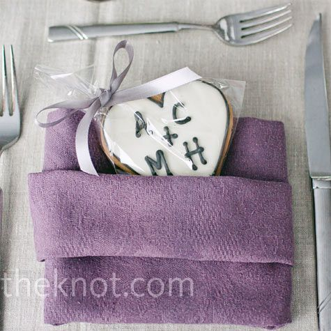 Monogrammed cookies tucked into lilac napkins