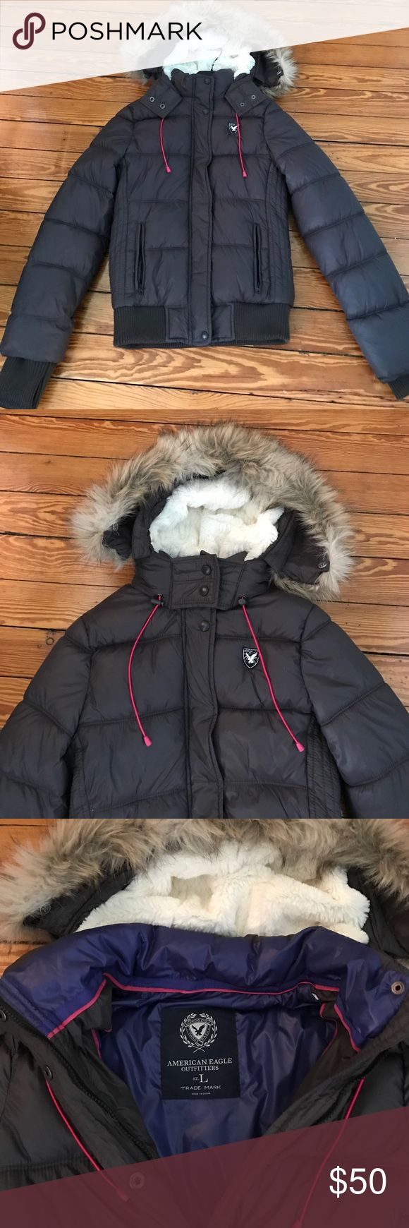Gray American Eagle puff jacket large never worn New without tags gray American Eagle puff jacket with warm fur lined hood.  Hood is NOT REMOVABLE but dark fur trim around hood is. American Eagle Outfitters Jackets & Coats