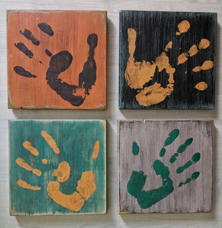 Family. 4 square of painted wood ,with each of my family member hand.