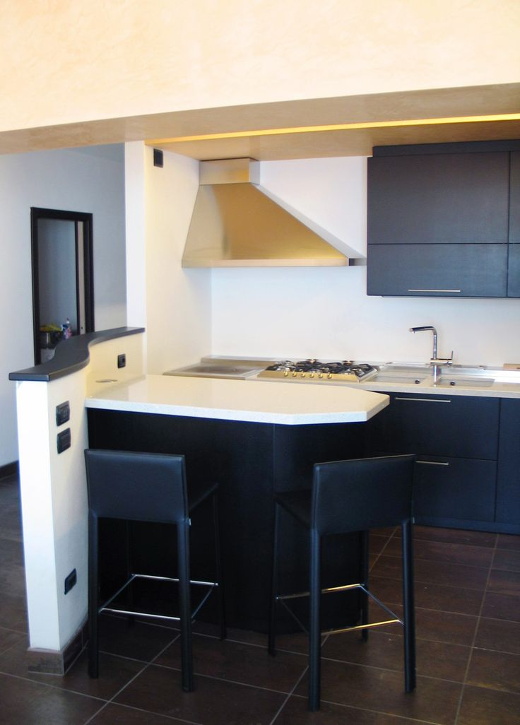 Custom kitchen made of black open pore durmast.