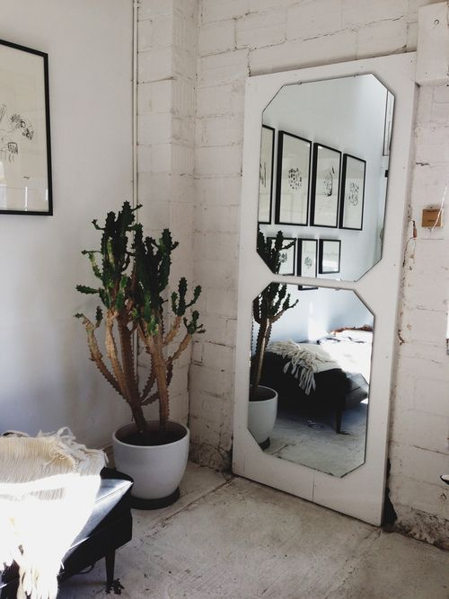 Use an old door as a frame for a mirror