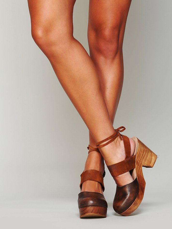Belmont Leather Clog | Strappy suede and leather clog. Wooden platform and heel with rubber outer sole. Adjustable buckle strap at back of heel. Also ties around the ankle.     *By Free People   *Artisan crafted from fine leathers and premium materials, FP Collection shoes are coveted for their signature vintage aesthetic.