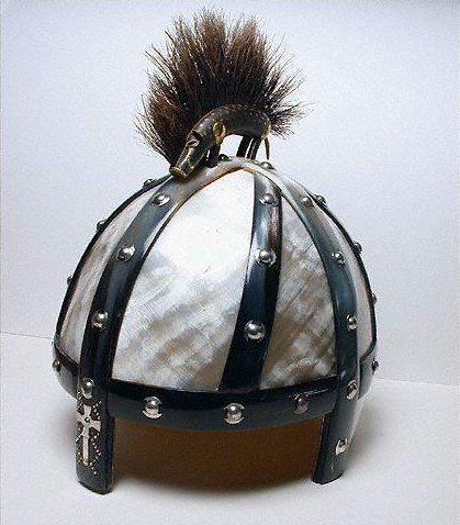 """The Benty Grange helm had """"two plates, one sub-rectangular and one sub-triangular, of horn.  (Horn, when heated, can be molded like modern plastic.)  The helm did not have the ocular that most Swedish helms had and does not seem to have any sort of cheek plate or neck guard. The helmet is undated, though the boar crest places it in the pre-Christian period before the late 7th century.  (The boar was intended to invoke the protection of the Germanic deity Freyr.)"""" And the cross?"""
