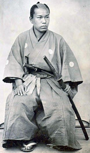 Samurai Named Yamada With Topknot, in Active, Seated Pose, Hand on Sword, 1869 4.25 x 3.25 inch Ambrotype.